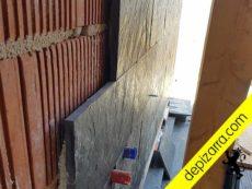 Colocación de pizarra calibrada en fachada.